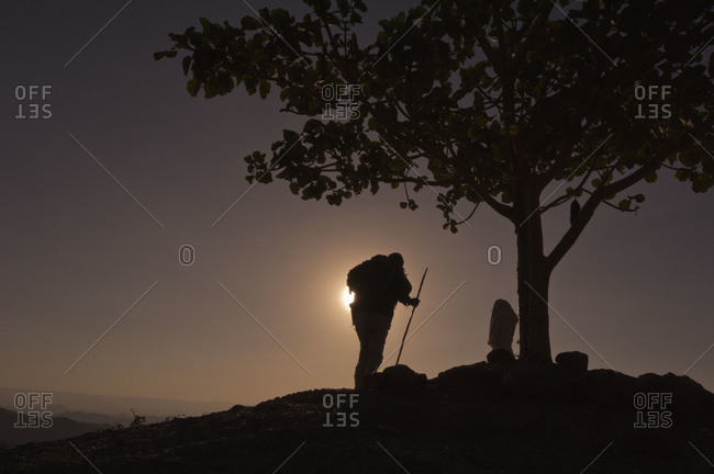 Man and woman standing in sunset in Lalibela, Ethiopia