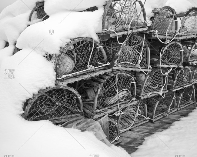 Snow-covered lobster catching baskets in Peggys Cove, Nova Scotia, Canada