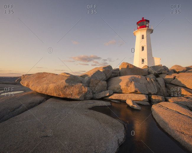 Sunset at Peggys Point Lighthouse in Peggys Cove, Nova Scotia, Canada