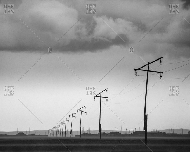 Landscape with houses and old wooden electricity poles in Mongolia