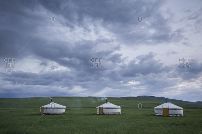 Landscape with three yurts in Mongolia
