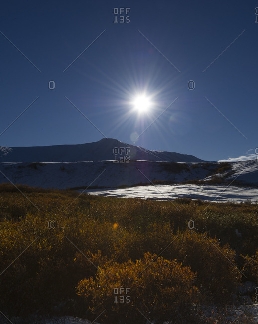 Sun shining above mountains at Tombstone Territorial Park in Yukon Territory, Canada