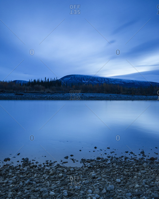 Stony lake shore in the evening in Yukon Territory, Canada