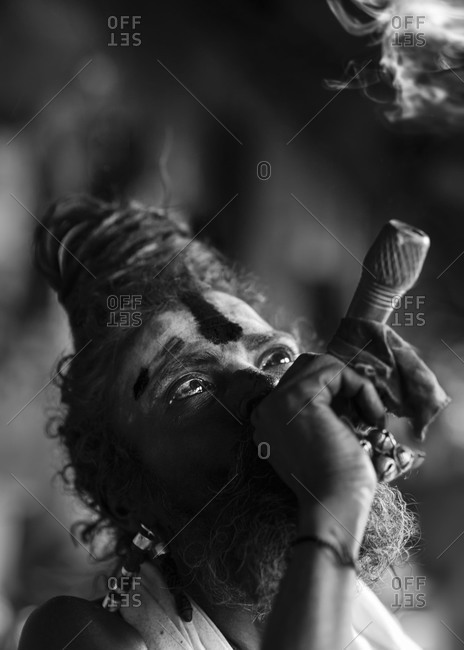 Portrait of sadhu smoking weeds in Kathmandu, Nepal
