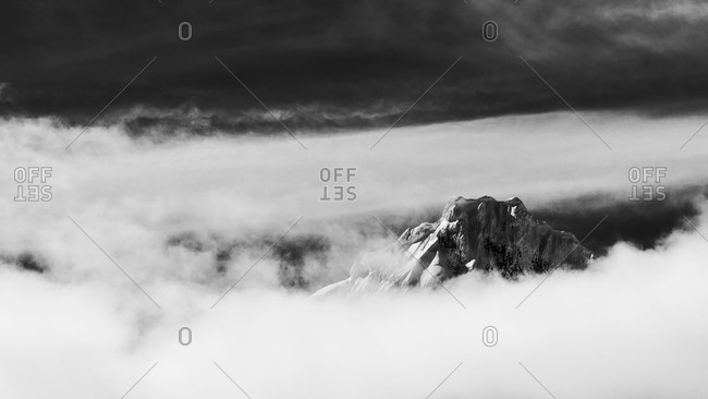 Mountain peak in clouds in Antarctica