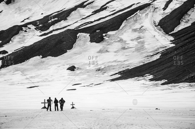 People standing at graves in Antarctica