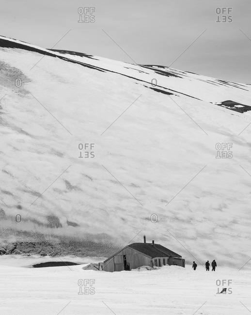 Snowy landscape with old house in Antarctica