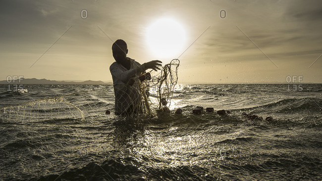 Silhouette of El Molo fisherman at Lake Turkana, Kenya, Africa.