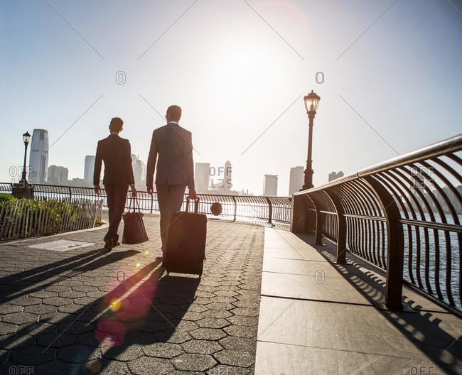 Silhouette of two young caucasian business men