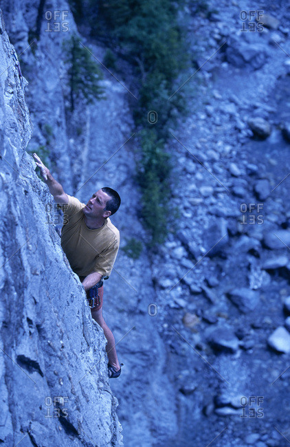 Man rock climbing, Kananaskis Country, Alberta, Canada