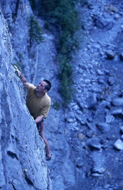 Man rock climbing, Kananaskis Country, Alberta, Canada