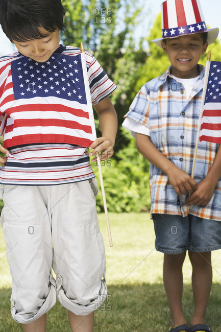 Boys holding American flags