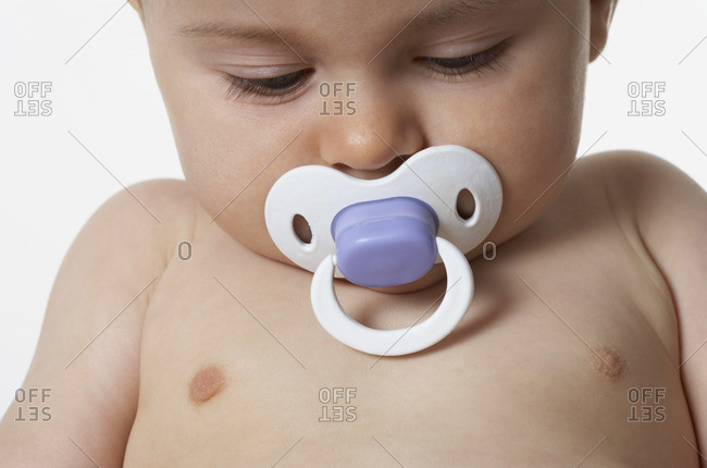 Portrait of baby with pacifier
