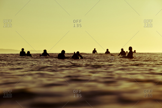 A group of surfers wait for waves at Rincon State Beach, in Santa Barbara, California.