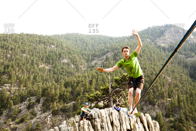 A male highliner walks the Elephant Buttresses highline in Boulder Canyon, Colorado.