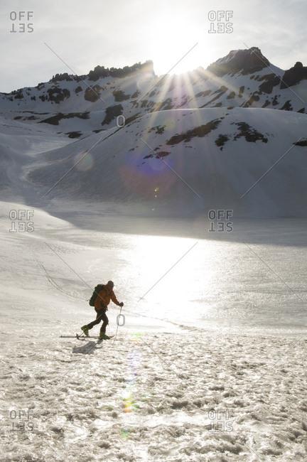 A man backcountry skiing in the San Juan National Forest, Silverton, Colorado.