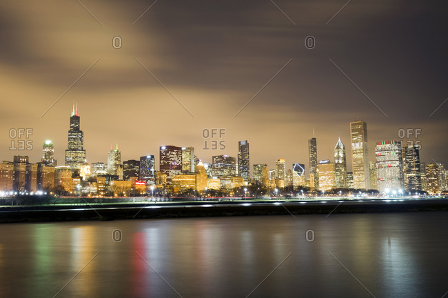 A night view of the Chicago skyline looking across Lake Michigan in Chicago, IL.