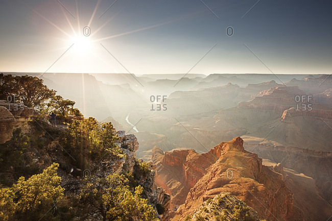 A scenic landscape view of a grand canyon landscape with sun rays.