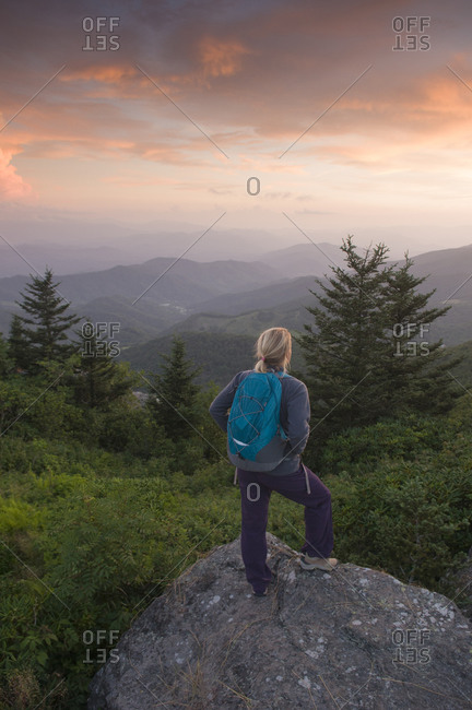 A woman hiker watching the sunset from Grassy Ridge, Bakersville, North Carolina.