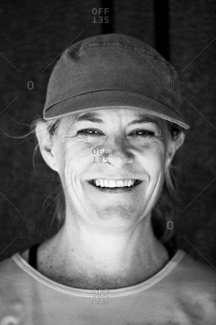A woman poses for a portrait after paddling a six-person outrigger canoe in Santa Barbara, California.