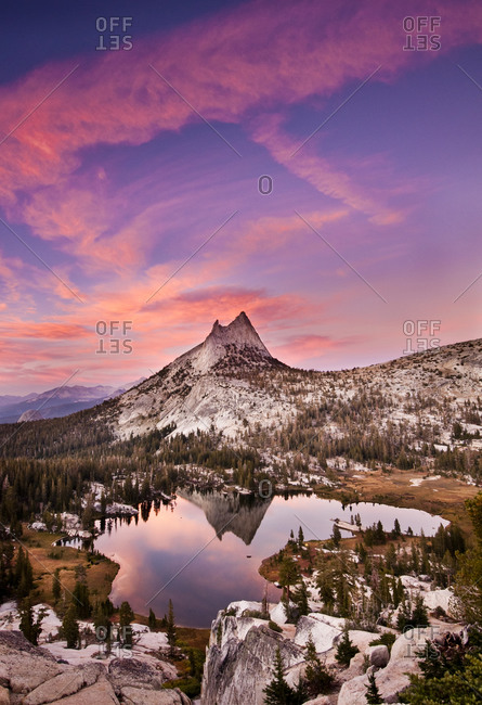 Cathedral Peak reflected in lake at sunset, Yosemite National Park, California