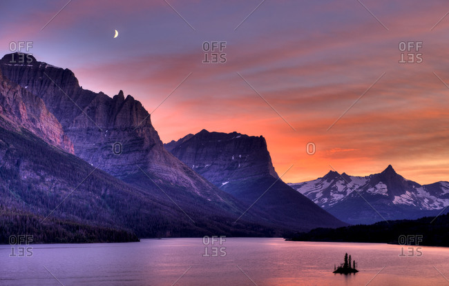 Cloudy sunset and moon over Saint Mary Lake, Glacier National Park, Montana