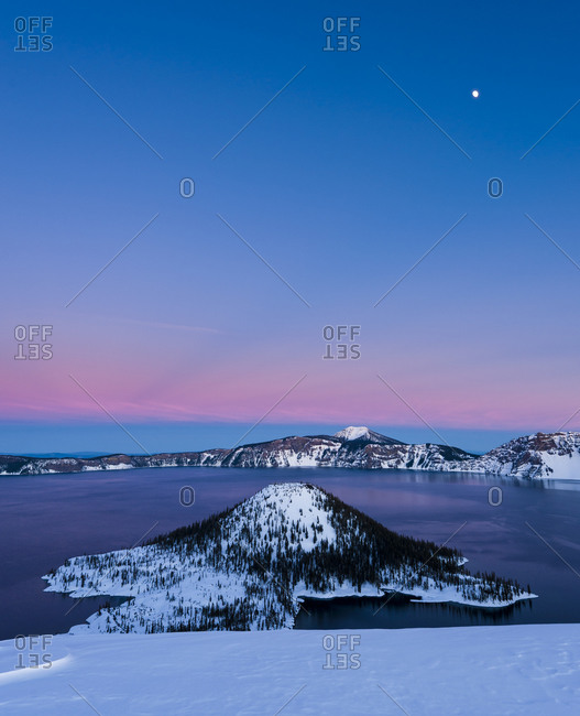 Crater Lake at sunset with full moon over Wizard Island, Crater Lake National Park, Oregon