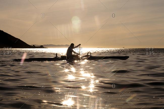 "Samuel ""Sammy"" Gonzalez paddles his one-man outrigger canoe off the coast of Ventura, California."