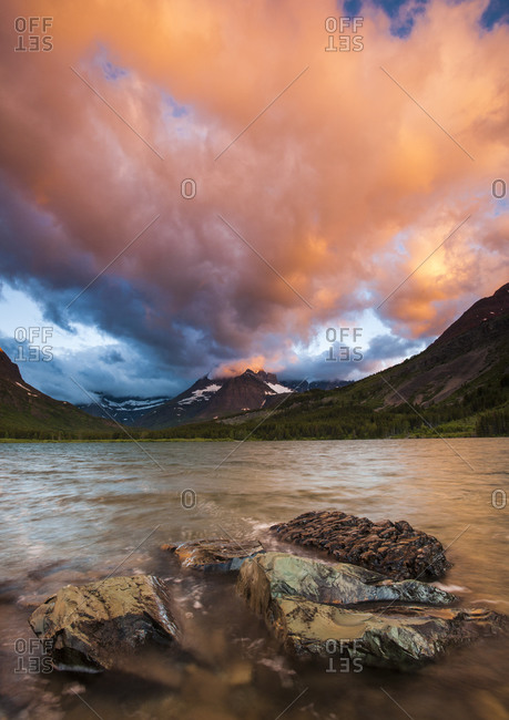 Stormy Sunrise over Swift Current Lake at Many Glacier, Glacier National Park, Montana