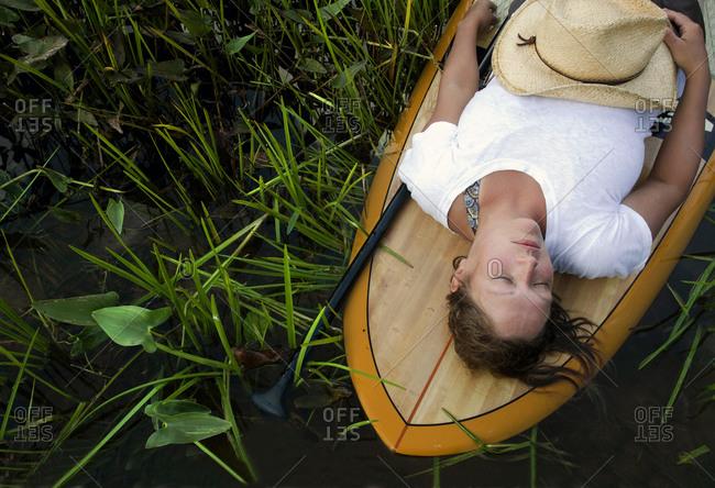 Woman naps on a SUP