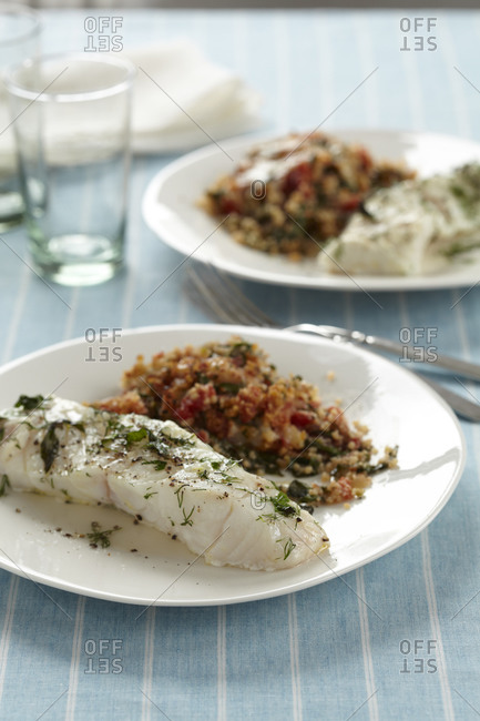 Baked lemon herb fish fillet served with couscous