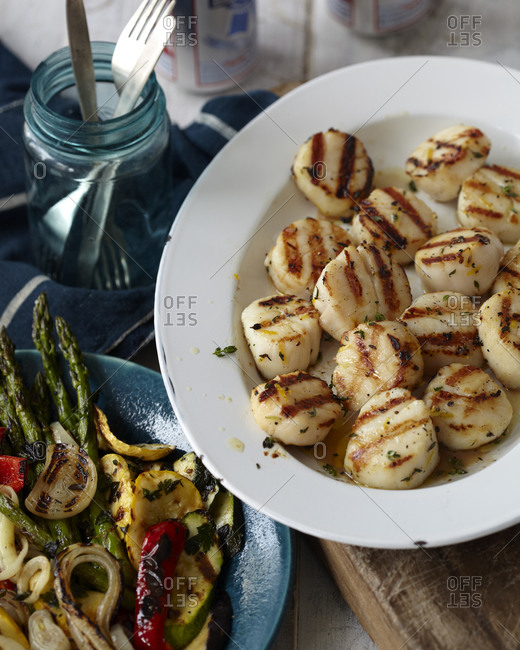 Grilled scallops with colorful vegetables.