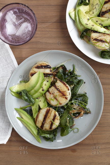 Grilled honey lime scallops with raw avocado.