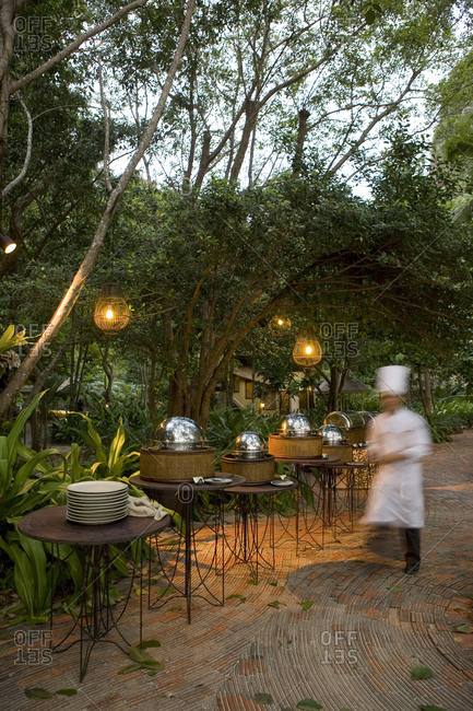 Hot selection in stainless steel chafing dishes under trees