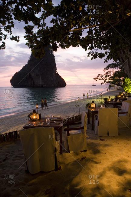 Restaurant The Grotto nestles under an ancient limestone cliff on Phranang Beach