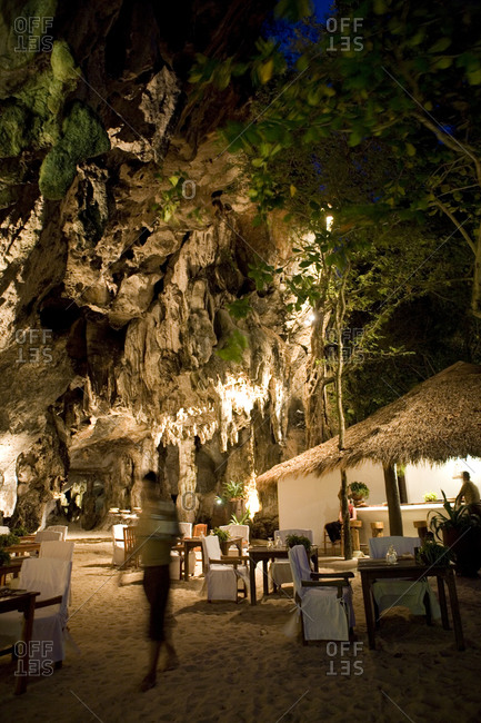 Restaurant The Grotto nestles under an ancient limestone cliff on the edge of Phranang Beach