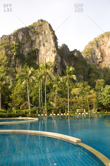 Luxury swimming pool with surrounding limestone cliff