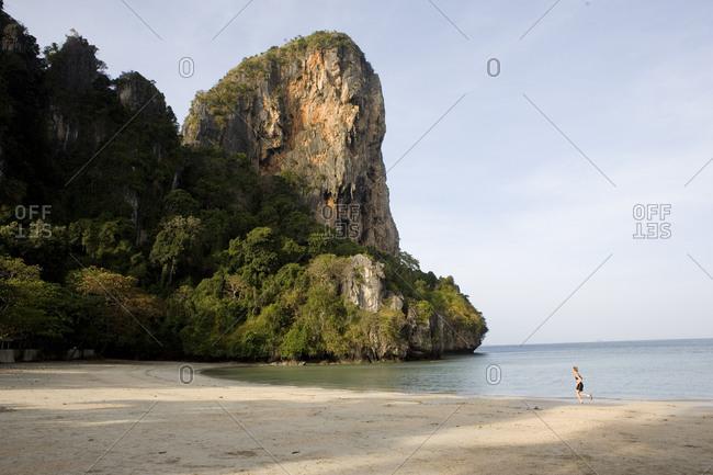 Unique sandy beach with surrounding limestone cliff