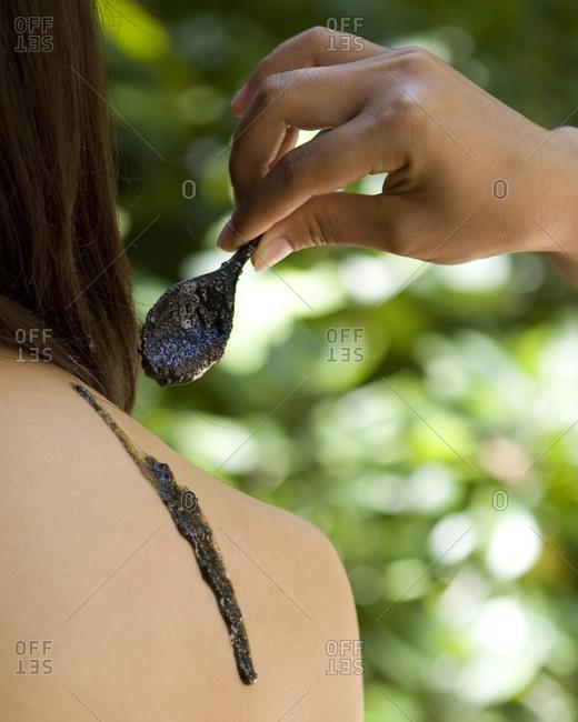 Woman back with nourishing scrub