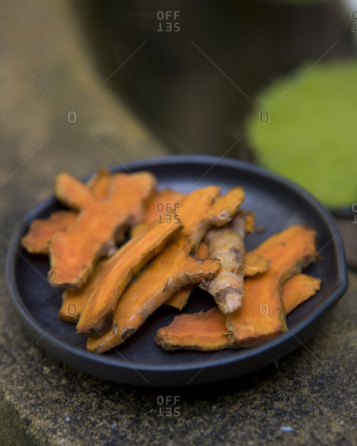 Close-up of sliced turmeric root