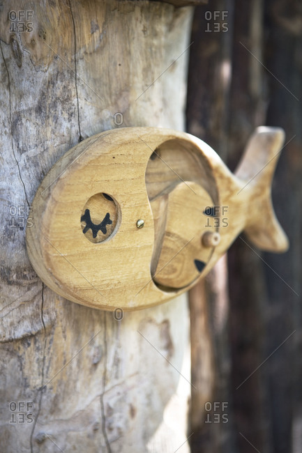 Close up of wooden fish ornament