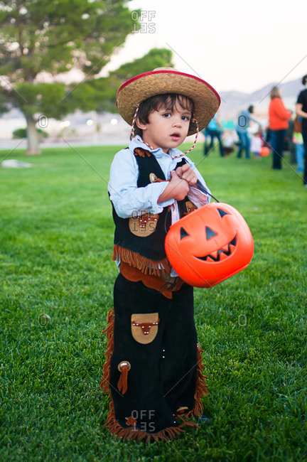 A little boy dressed as a cowboy for halloween