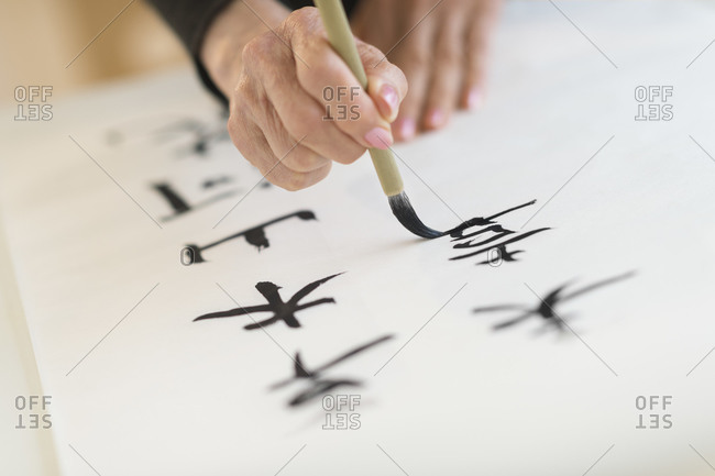 Female hand and japanese calligraphy