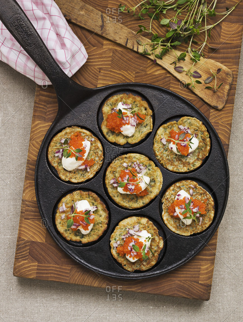 Herbs pancakes with soured cream