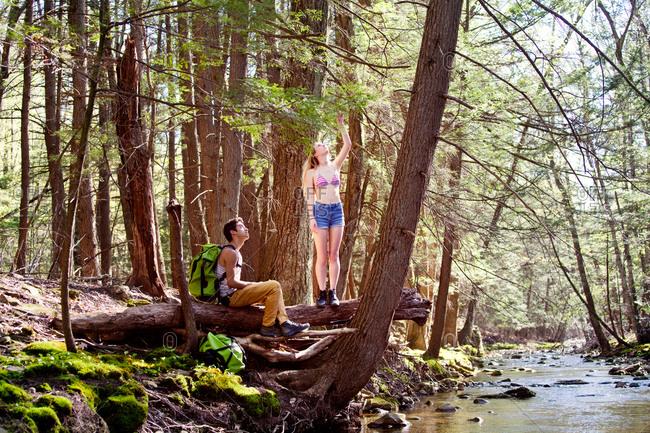 Couple resting next to mountain stream