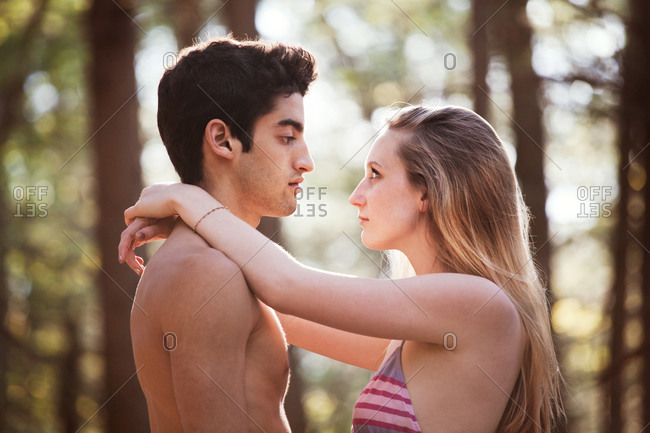 Side view of couple standing in forest