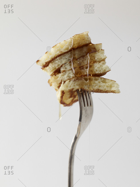 Pancake with syrup on fork