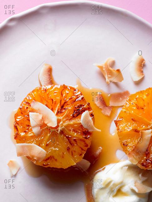 Prepared orange dessert with cream on plate