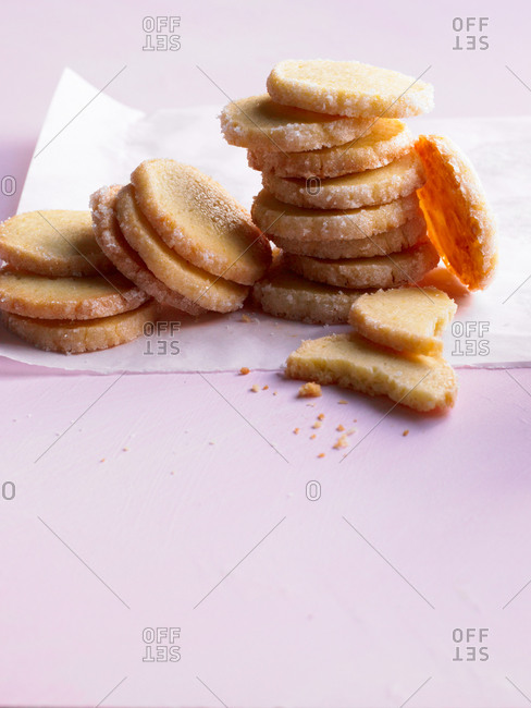 Cookies on a napkin against pink background