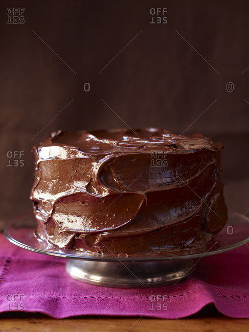 Devil's food cake on magenta napkin against dark background